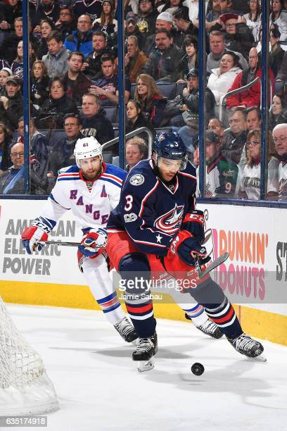 Seth Jones of the Columbus Blue Jackets skates the puck away from Rick Nash of the New York Rangers during the second period of a game on February 13...
