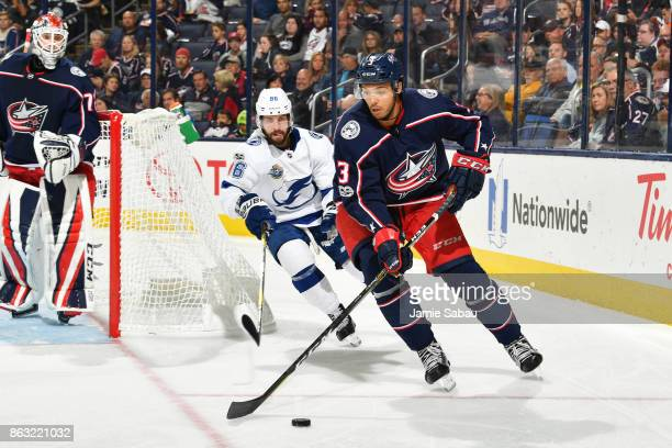Seth Jones of the Columbus Blue Jackets skates the puck away from Nikita Kucherov of the Tampa Bay Lightning during the second period of a game on...