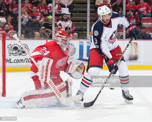 Seth Jones of the Columbus Blue Jackets tries to tip the puck as Petr Mrazek of the Detroit Red Wings drops down to make a save during an NHL game at...