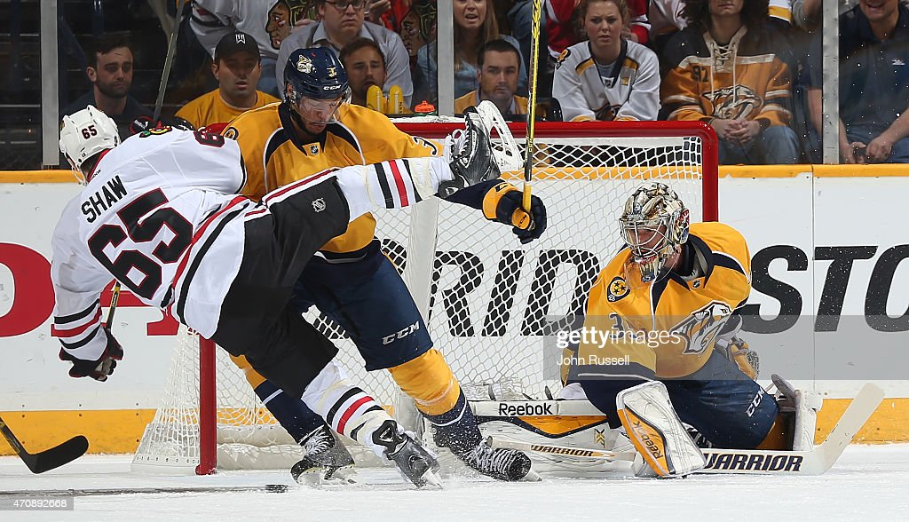 Seth Jones #3 of the Nashville Predators battles against Andrew Shaw #65 of the Chicago Blackhawks as goalie Pekka Rinne #35 eyes the puck in Game Five of the Western Conference Quarterfinals during the 2015 NHL Stanley Cup Playoffs at Bridgestone Arena on April 23, 2015 in Nashville, Tennessee.