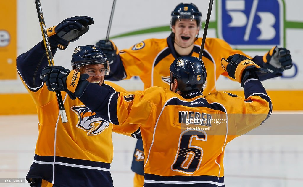 Seth Jones #3 of the Nashville Predators celebrates his first NHL goal with <a gi-track='captionPersonalityLinkClicked' href=/galleries/search?phrase=Shea+Weber&family=editorial&specificpeople=554412 ng-click='$event.stopPropagation()'>Shea Weber</a> #6 against the New York Islanders at Bridgestone Arena on October 12, 2013 in Nashville, Tennessee.