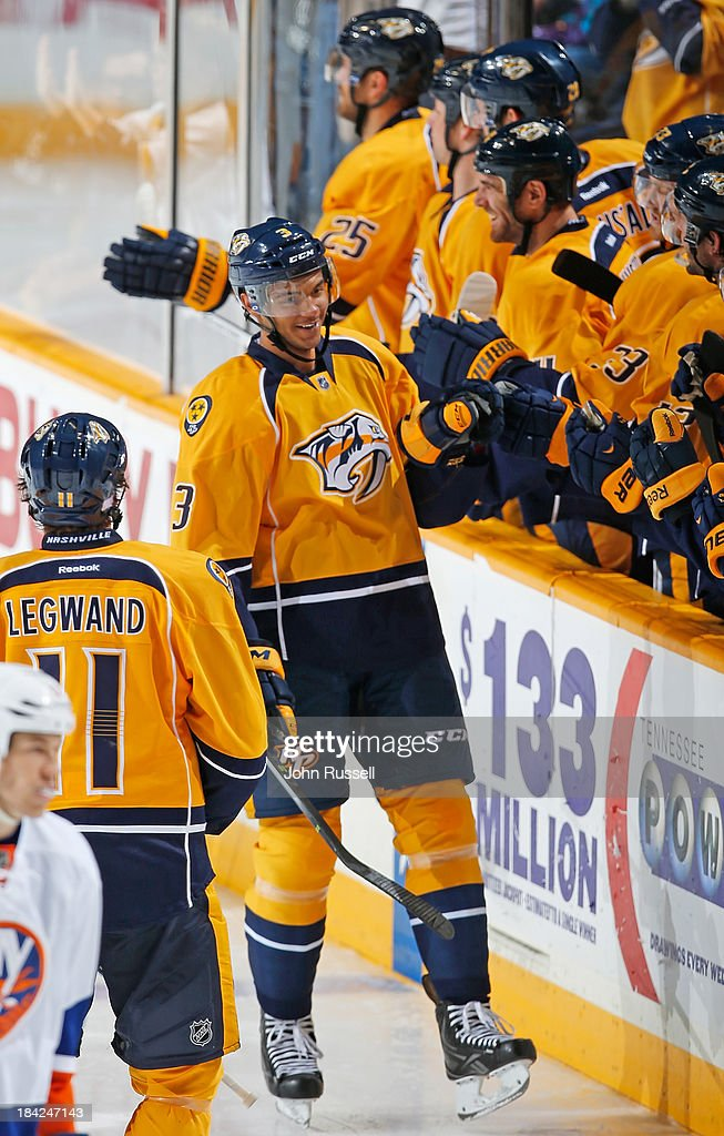 Seth Jones #3 of the Nashville Predators celebrates his first NHL goal along the bench against of the New York Islanders at Bridgestone Arena on October 12, 2013 in Nashville, Tennessee.
