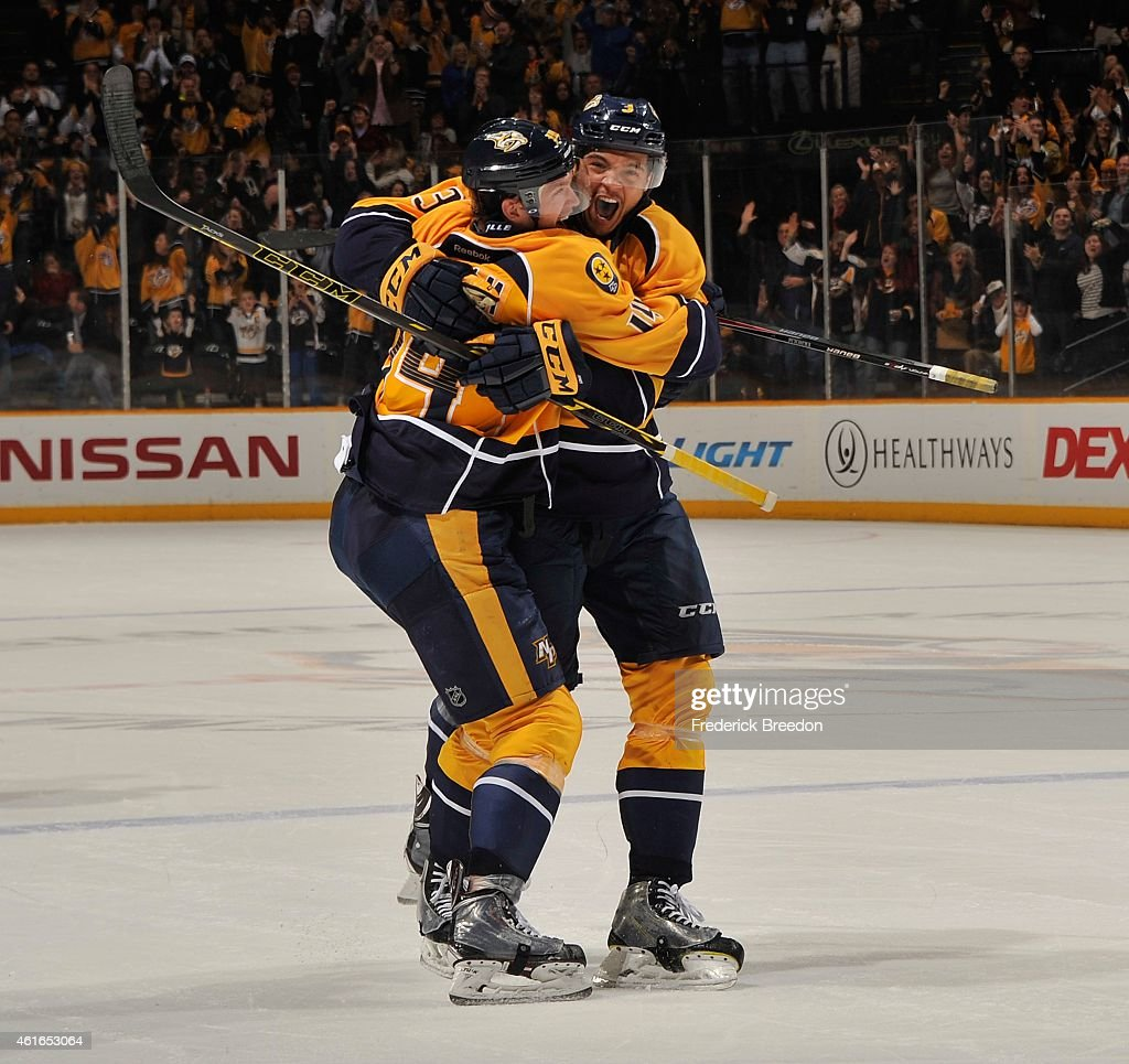Seth Jones of the Nashville Predators congratulates teammate Mattias Ekholm on scoring the game tying goal against the Washington Capitals during the...