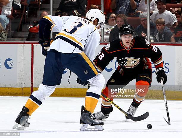 Seth Jones of the Nashville Predators handles the puck against Jakob Silfverberg of the Anaheim Ducks on March 15 2015 at Honda Center in Anaheim...