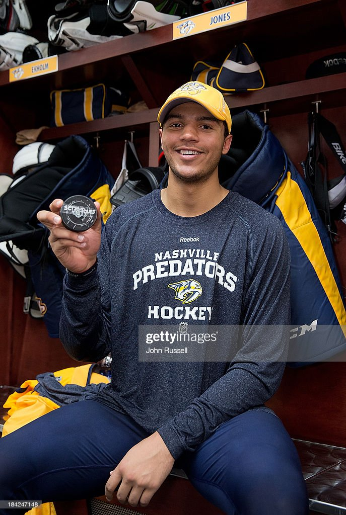 Seth Jones #3 of the Nashville Predators holds his first NHL goal puck following a win against of the New York Islanders at Bridgestone Arena on October 12, 2013 in Nashville, Tennessee.