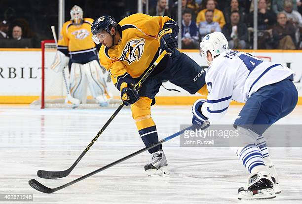 Seth Jones of the Nashville Predators passes the puck against the Toronto Maple Leafs during an NHL game at Bridgestone Arena on February 3 2015 in...