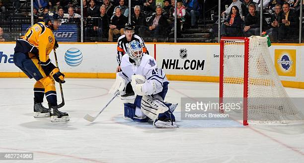 Seth Jones of the Nashville Predators scores a goal against goalie Jonathan Bernier of the Toronto Maple Leafs during the first period at Bridgestone...