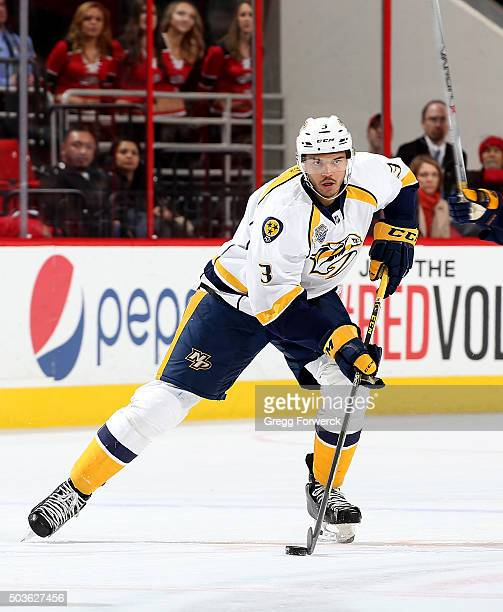 Seth Jones of the Nashville Predators skates with the puck during an NHL game against the Carolina Hurricanes at PNC Arena on January 2 2016 in...