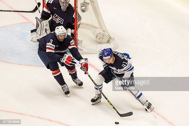 Seth Jones of the United States and Antii Pihlstrom of Finland battle for the puck during the IIHF World Championship group B match between USA and...