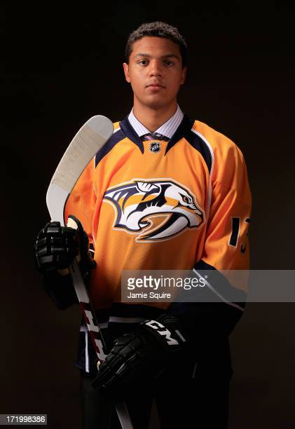 Seth Jones poses for a portrait after being selected number four overall in the first round by the Nashville Predators during the 2013 NHL Draft at...