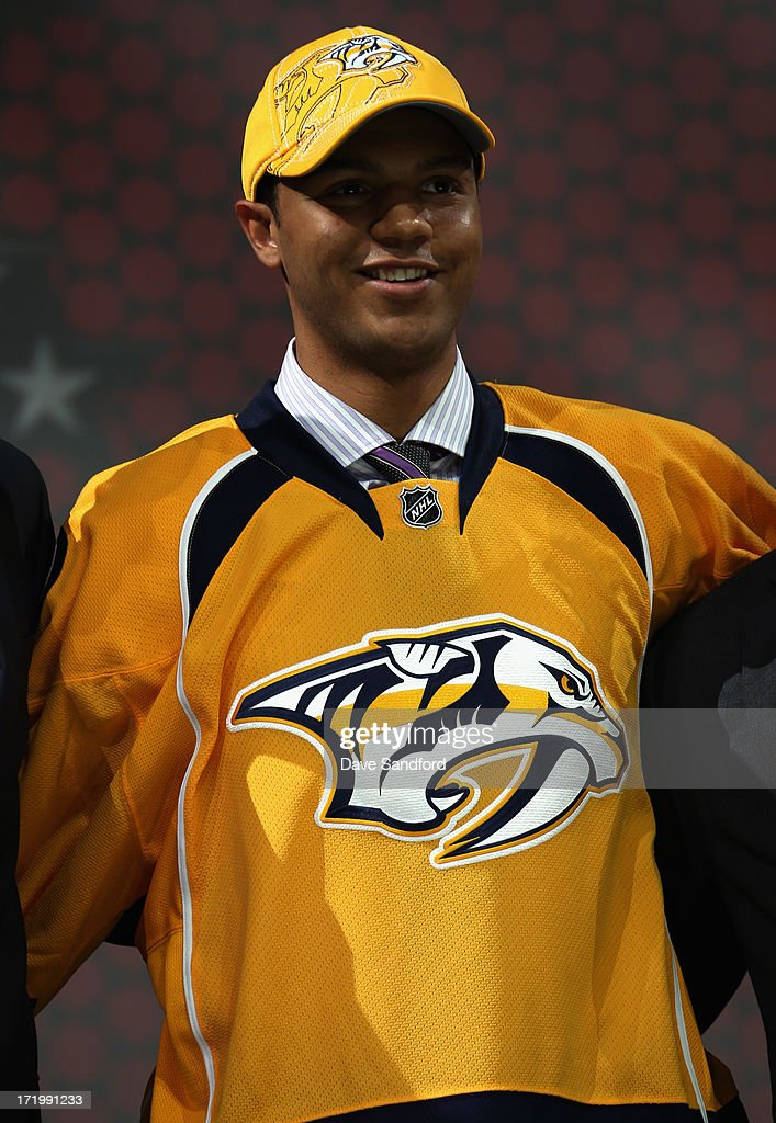 Seth Jones smiles on stage after he was selected fourth overall by the Nashiville Predators during the 2013 NHL Draft at Prudential Center on June 30, 2013 in Newark, New Jersey.