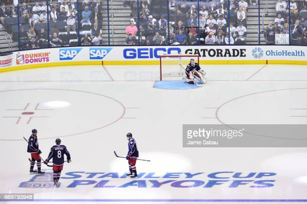 Seth Jones Zach Werenski Brandon Dubinsky and goaltender Sergei Bobrovsky all of the Columbus Blue Jackets get ready for the second period in Game...