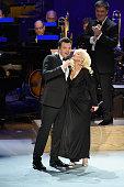 Seth MacFarlane Christina Aguilera and New York Philharmonic Music Director Alan Gilbert perform onstage during the Sinatra Gala with New York...