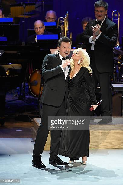 Seth MacFarlane Christina Aguilera and New York Philharmonic Music Director Alan Gilbert perform onstage during the Sinatra Gala with New York...