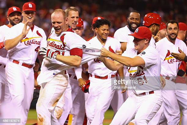 Seth Maness of the St Louis Cardinals celebrates with Brandon Moss of the St Louis Cardinals after Moss hit a walkoff solo home run against the...