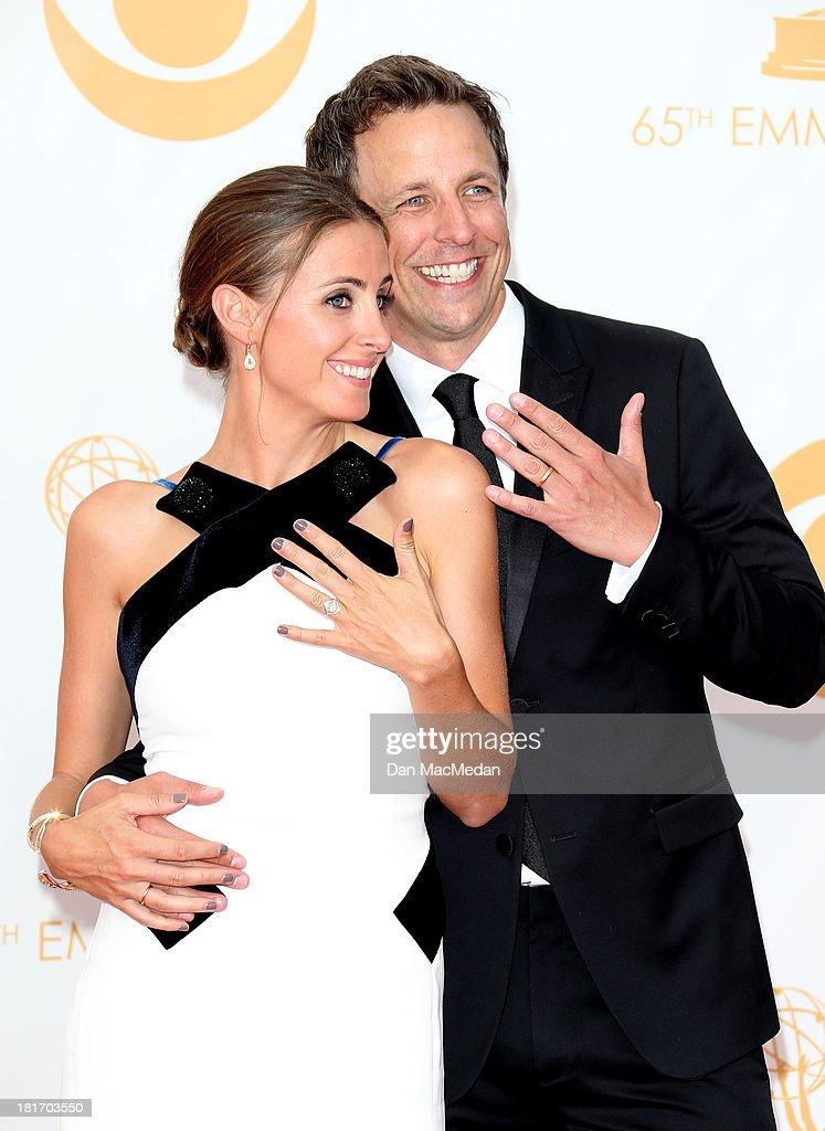 Seth Meyers and Alexi Ashe arrive at the 65th Annual Primetime Emmy Awards at Nokia Theatre LA Live on September 22 2013 in Los Angeles California