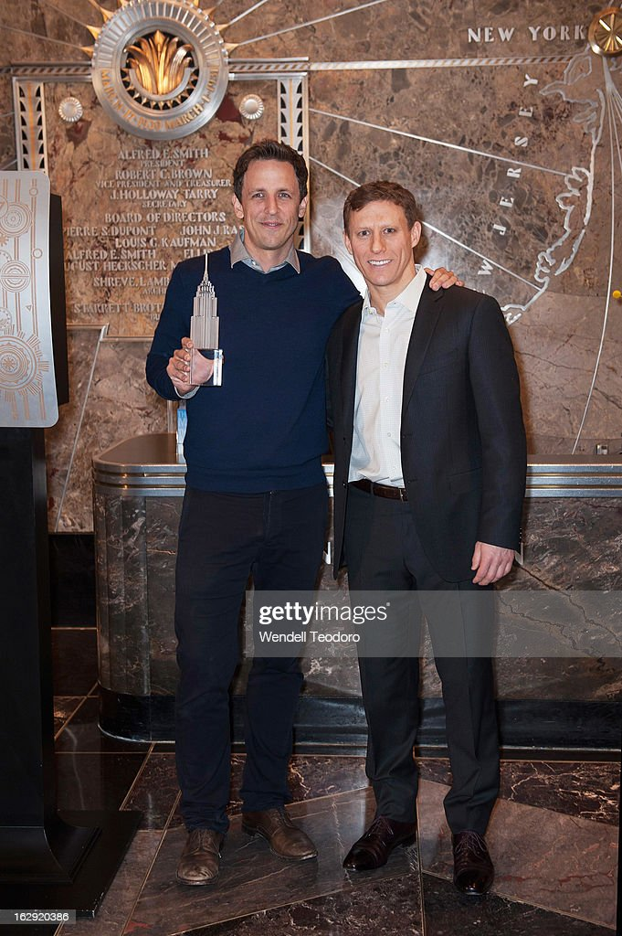 Seth Meyers and Cycle for Survival Co-Founder David Linn attends the lights The Empire State Building on March 1, 2013 in New York City.