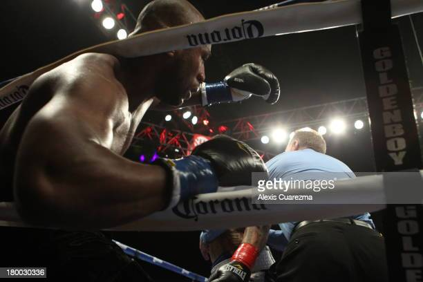 Seth Mitchell falls against the ropes as referee Jack Reiss pushes Chris Arreola away calling a TKO during their WBC International Heavyweight Title...