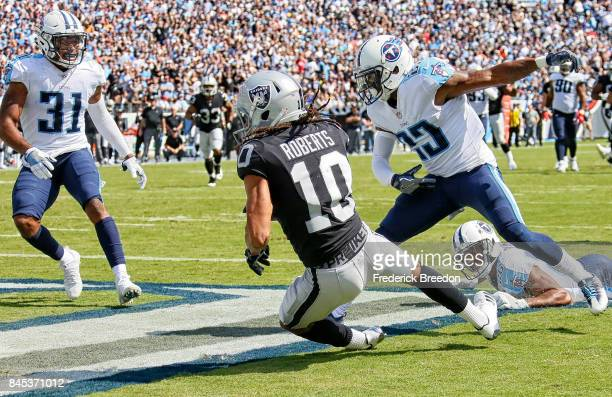 Seth Roberts of the Oakland Raiders scores a touchdown against the Tennessee Titans during the second half at Nissan Stadium on September 10 2017 in...