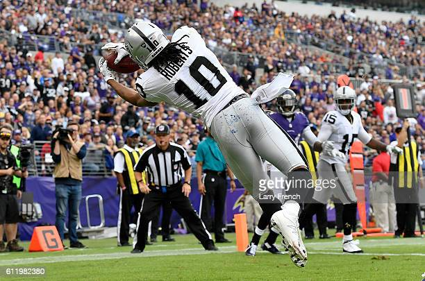 Seth Roberts of the Oakland Raiders scores a touchdown in the first quarter against the Baltimore Ravens at MT Bank Stadium on October 2 2016 in...