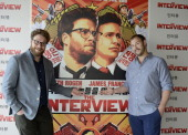 Seth Rogen and Evan Goldberg pose during a photocall for their latest film 'The Interview' at the Hotel Mandarin on June 18 2014 in Barcelona Spain