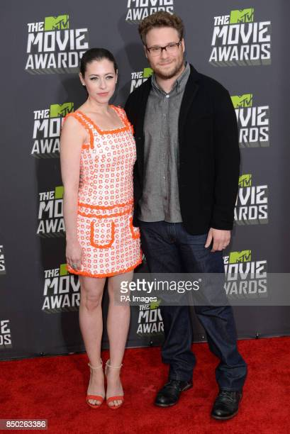 Seth Rogen and wife Lauren Miller arrive at The MTV Movie Awards 2013 at Sony Pictures Studios Culver City Los Angeles