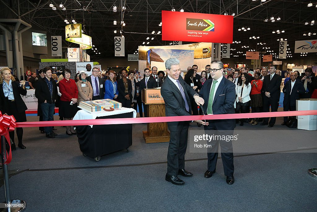 Seth Rogin (R), Vice President of Advertising at The New York Times, and Tony Gonchar, Vice President of Representative Network at American Express U.S. Consumer Travel Network attend The 10th Annual New York Times Travel Show Ribbon Cutting And Preview at Javits Center on January 18, 2013 in New York City.