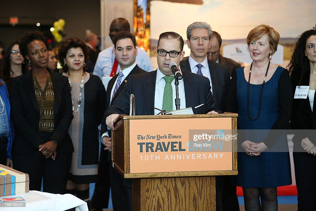 Seth Rogin (C), Vice President of Advertising at The New York Times speaks at The 10th Annual New York Times Travel Show Ribbon Cutting And Preview at Javits Center on January 18, 2013 in New York City.