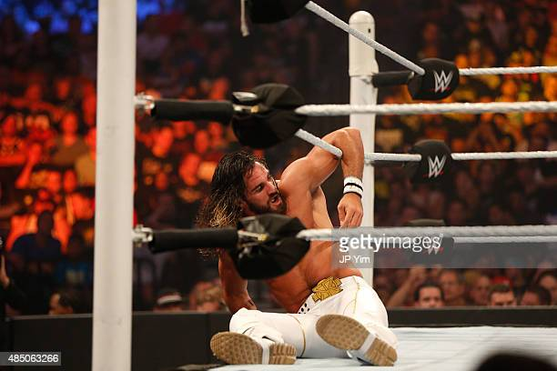 Seth Rollins recovers from a blow during his fight against John Cena at the WWE SummerSlam 2015 at Barclays Center of Brooklyn on August 23 2015 in...