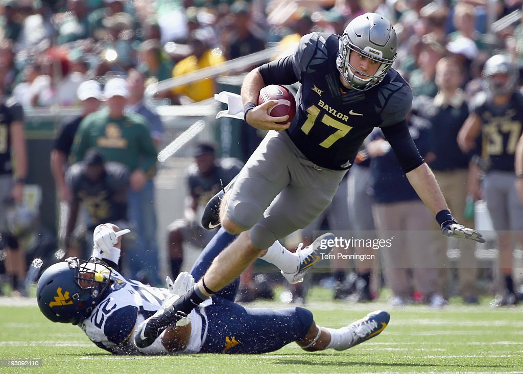 Seth Russell of the Baylor Bears carries the ball against Jarrod Harper of the West Virginia Mountaineers in the third quarter at McLane Stadium on...