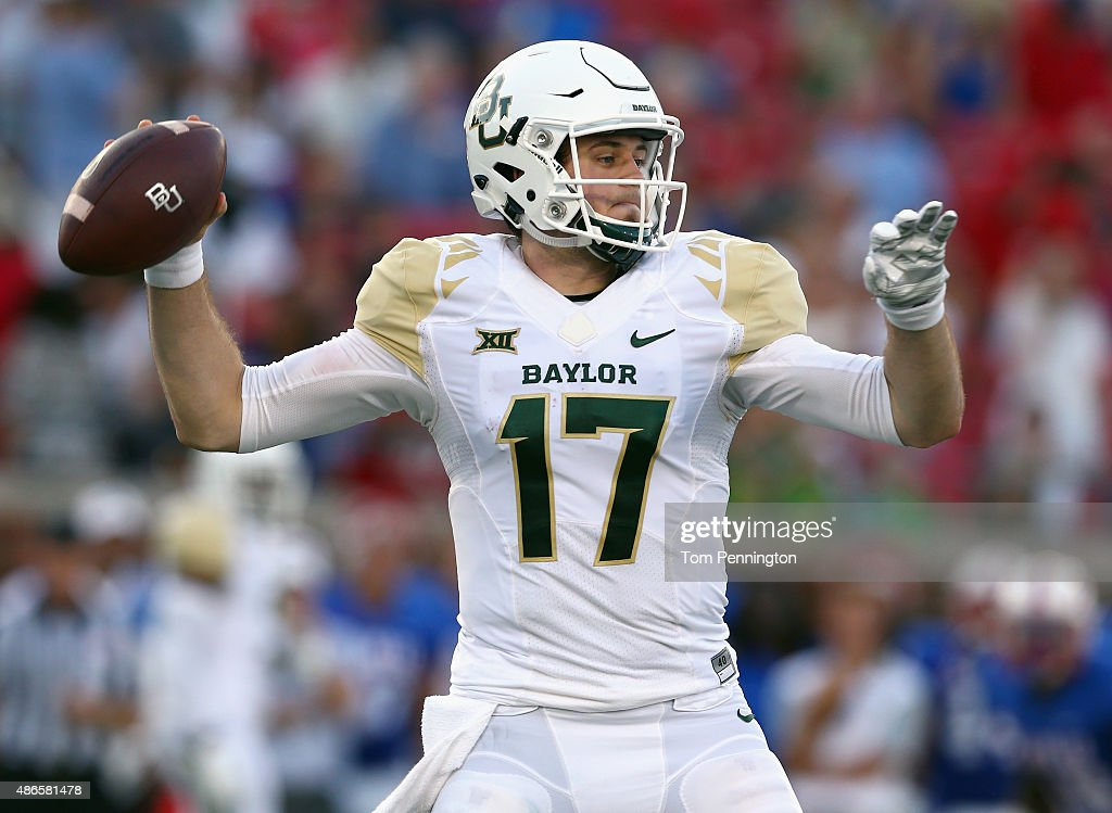 Seth Russell of the Baylor Bears looks for an open receiver against the Southern Methodist Mustangs in the second quarter at Gerald J Ford Stadium on...