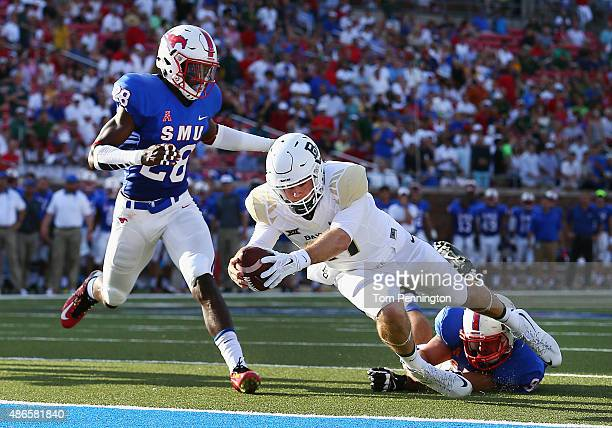 Seth Russell of the Baylor Bears scores a touchdown against Justin Lawler of the Southern Methodist Mustangs and Shakiel Randolph of the Southern...