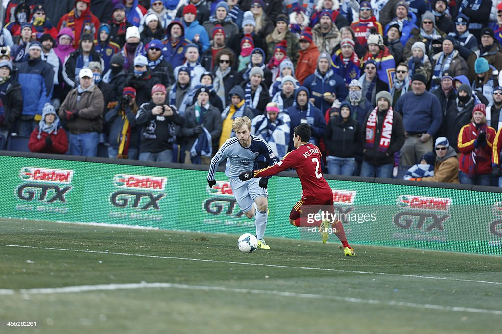 Seth Sinovic of Sporting Kansas City works the ball against Tony Beltran of Real Salt Lake during the MLS Cup Final at Sporting Park on December 7...