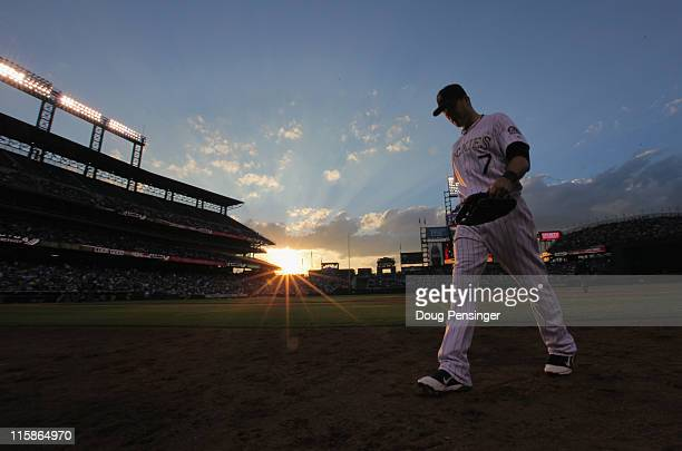 Seth Smith of the Colorado Rockies heads for the dugout between innings against the Los Angeles Dodgers at Coors Field on June 10 2011 in Denver...