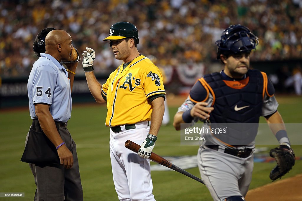 Seth Smith #15 of the Oakland Athletics agrues with the home plate umpire after being struck out in the second inning against the Detroit Tigers during Game Two of the American League Division Series at O.co Coliseum on October 5, 2013 in Oakland, California.