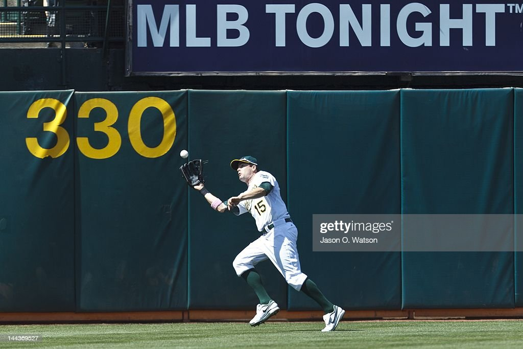 <a gi-track='captionPersonalityLinkClicked' href=/galleries/search?phrase=Seth+Smith&family=editorial&specificpeople=3190174 ng-click='$event.stopPropagation()'>Seth Smith</a> #15 of the Oakland Athletics catches a fly ball hit off the bat of Prince Fielder #28 of the Detroit Tigers (not pictured) during the seventh inning at O.co Coliseum on May 13, 2012 in Oakland, California. The Detroit Tigers defeated the Oakland Athletics 3-1. Photo by Jason O. Watson/Getty Images)