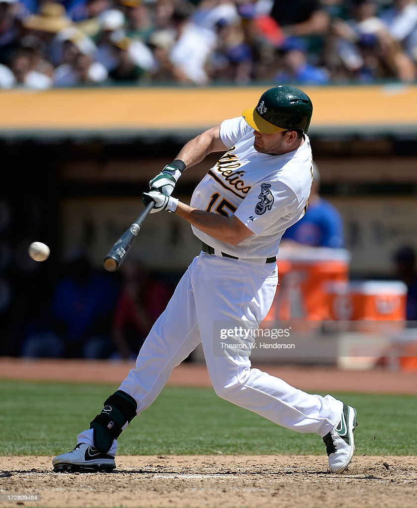<a gi-track='captionPersonalityLinkClicked' href=/galleries/search?phrase=Seth+Smith&family=editorial&specificpeople=3190174 ng-click='$event.stopPropagation()'>Seth Smith</a> #15 of the Oakland Athletics hit a base hit with two out in the seventh inning against the Chicago Cubs at O.co Coliseum on July 4, 2013 in Oakland, California. The Athletics defeated the Cubs 1-0.