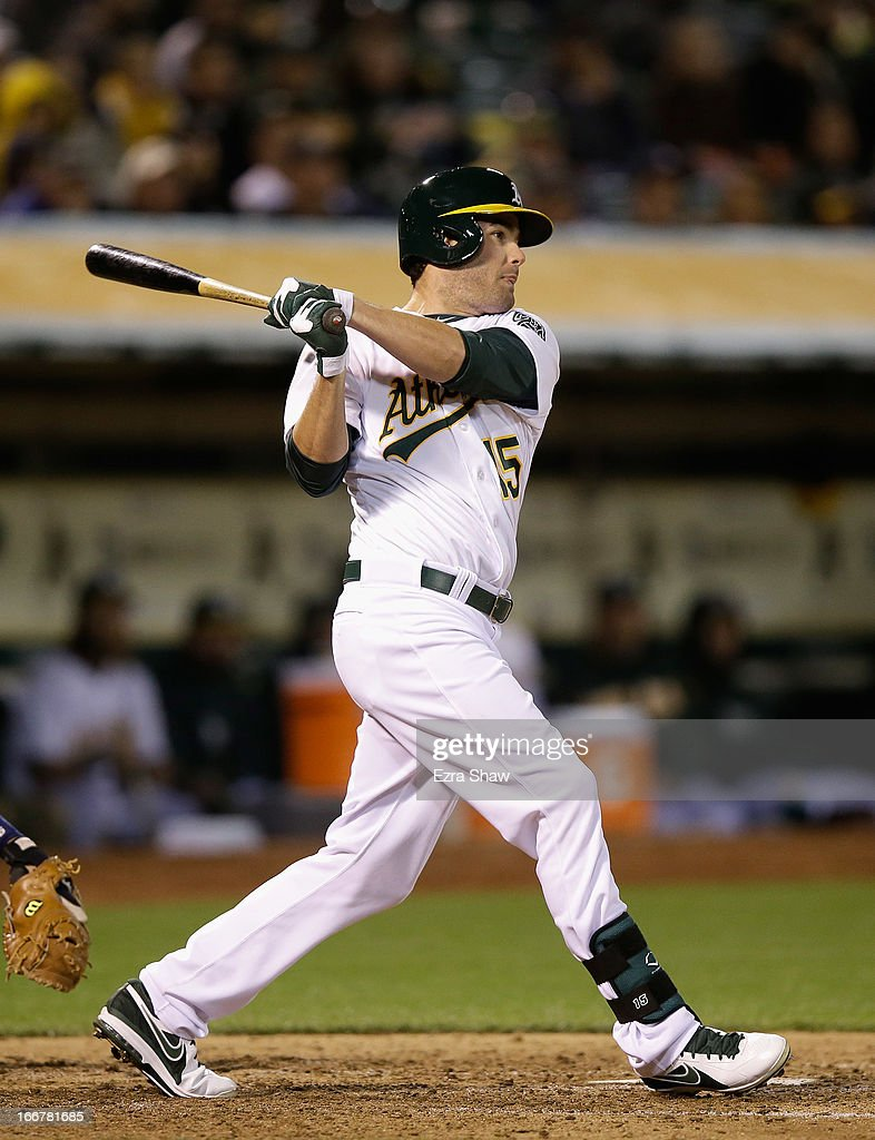 <a gi-track='captionPersonalityLinkClicked' href=/galleries/search?phrase=Seth+Smith&family=editorial&specificpeople=3190174 ng-click='$event.stopPropagation()'>Seth Smith</a> #15 of the Oakland Athletics hits a single that scored Coco Crisp #4 in the fifth inning of their game against the Houston Astros at O.co Coliseum on April 16, 2013 in Oakland, California.