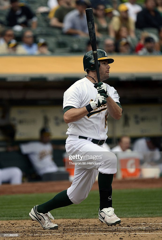 <a gi-track='captionPersonalityLinkClicked' href=/galleries/search?phrase=Seth+Smith&family=editorial&specificpeople=3190174 ng-click='$event.stopPropagation()'>Seth Smith</a> #15 of the Oakland Athletics hits an RBI single driving in Derek Norris #36 in the third inning against the Los Angeles Angels of Anaheim at O.co Coliseum on September 5, 2012 in Oakland, California.