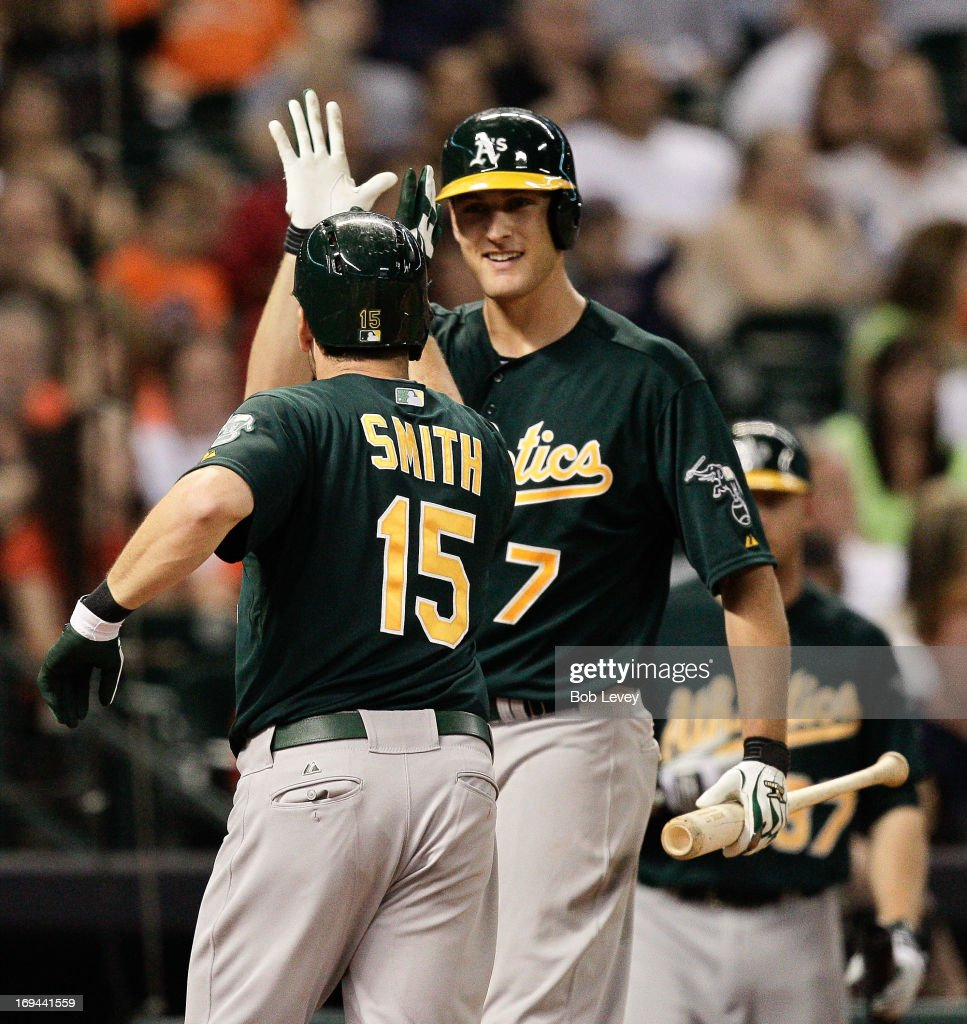 <a gi-track='captionPersonalityLinkClicked' href=/galleries/search?phrase=Seth+Smith&family=editorial&specificpeople=3190174 ng-click='$event.stopPropagation()'>Seth Smith</a> #15 of the Oakland Athletics receives a high five from Nate Freiman #7 of the Oakland Athletics after hitting a home run in the sixth inning against the Houston Astros at Minute Maid Park on May 24, 2013 in Houston, Texas.