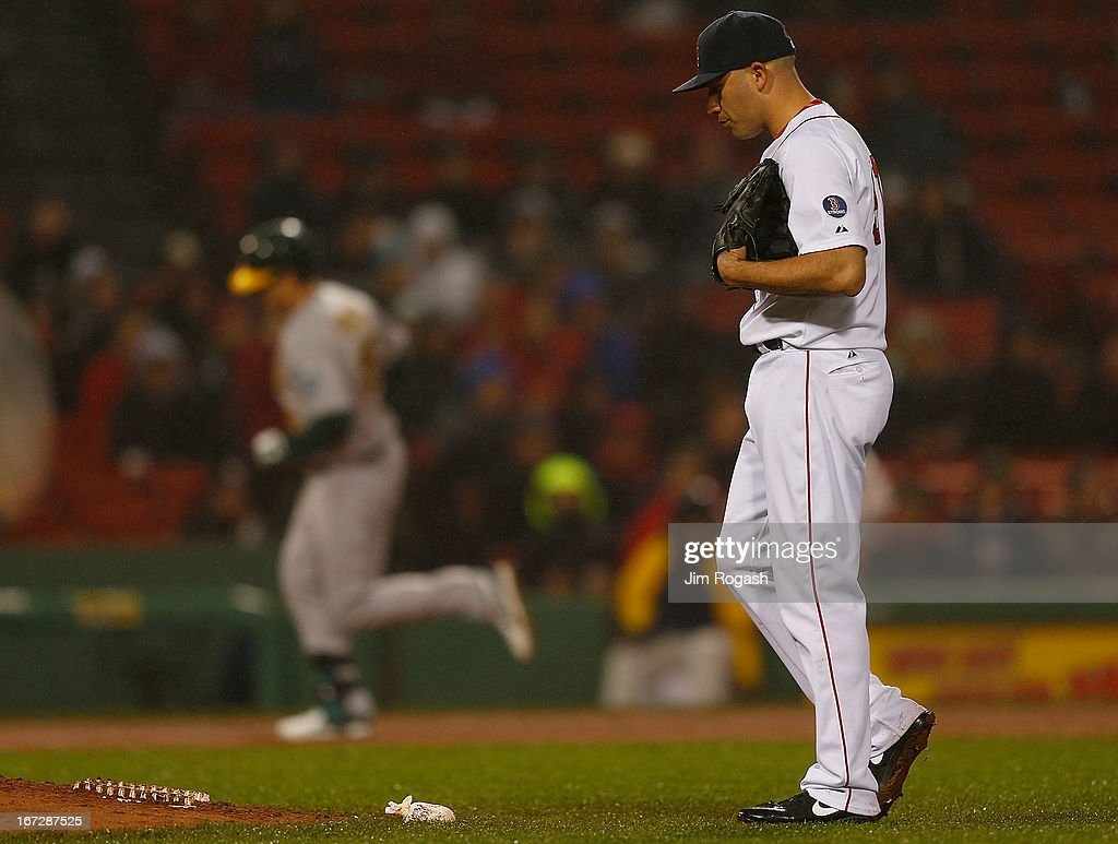 <a gi-track='captionPersonalityLinkClicked' href=/galleries/search?phrase=Seth+Smith&family=editorial&specificpeople=3190174 ng-click='$event.stopPropagation()'>Seth Smith</a> #15 of the Oakland Athletics rounds the bases after hitting a home run against <a gi-track='captionPersonalityLinkClicked' href=/galleries/search?phrase=Alfredo+Aceves&family=editorial&specificpeople=5514493 ng-click='$event.stopPropagation()'>Alfredo Aceves</a> #91 of the Boston Red Sox pauses in the 4th inning at Fenway Park on April 23, 2013 in Boston, Massachusetts.