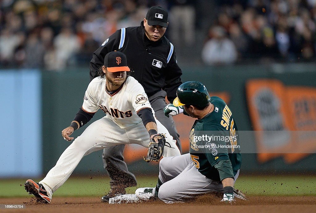 <a gi-track='captionPersonalityLinkClicked' href=/galleries/search?phrase=Seth+Smith&family=editorial&specificpeople=3190174 ng-click='$event.stopPropagation()'>Seth Smith</a> #15 of the Oakland Athletics slides into second base with a double, beating the tag of <a gi-track='captionPersonalityLinkClicked' href=/galleries/search?phrase=Brandon+Crawford&family=editorial&specificpeople=5580312 ng-click='$event.stopPropagation()'>Brandon Crawford</a> #35 of the San Francisco Giants in the fourth inning at AT&T Park on May 29, 2013 in San Francisco, California.
