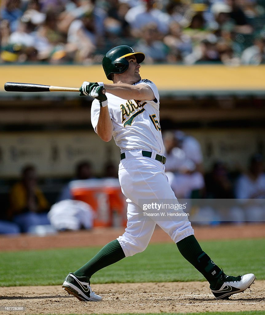 Seth Smith #15 of the Oakland Athletics swings and watches the flight of his ball as he hits a two-run home run against the Baltimore Orioles in the seventh inning at O.co Coliseum on April 28, 2013 in Oakland, California.