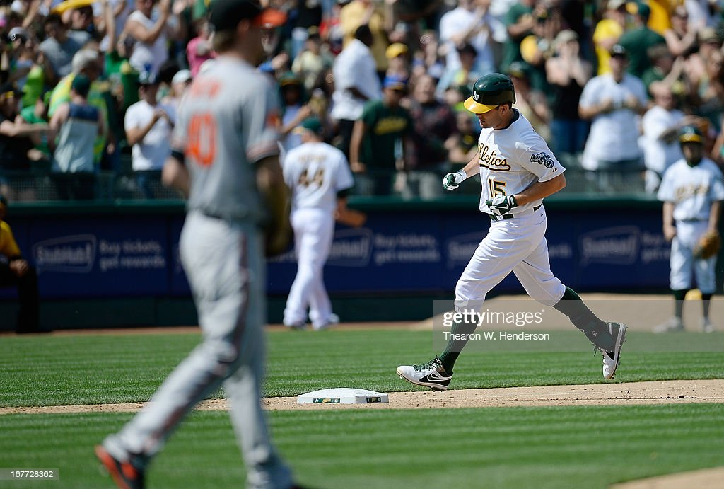 Seth Smith #15 of the Oakland Athletics trots around the bases after hitting a two-run home run as pitcher Troy Patton #40 of the Baltimore Orioles walks back to the mound in the seventh inning at O.co Coliseum on April 28, 2013 in Oakland, California.