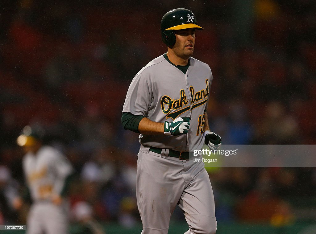 <a gi-track='captionPersonalityLinkClicked' href=/galleries/search?phrase=Seth+Smith&family=editorial&specificpeople=3190174 ng-click='$event.stopPropagation()'>Seth Smith</a> #15 of the Oakland Athletics walks with the bases loaded allowing Eric Sogard #28 to score in the 3rd inning against the Boston Red Sox at Fenway Park on April 23, 2013 in Boston, Massachusetts.