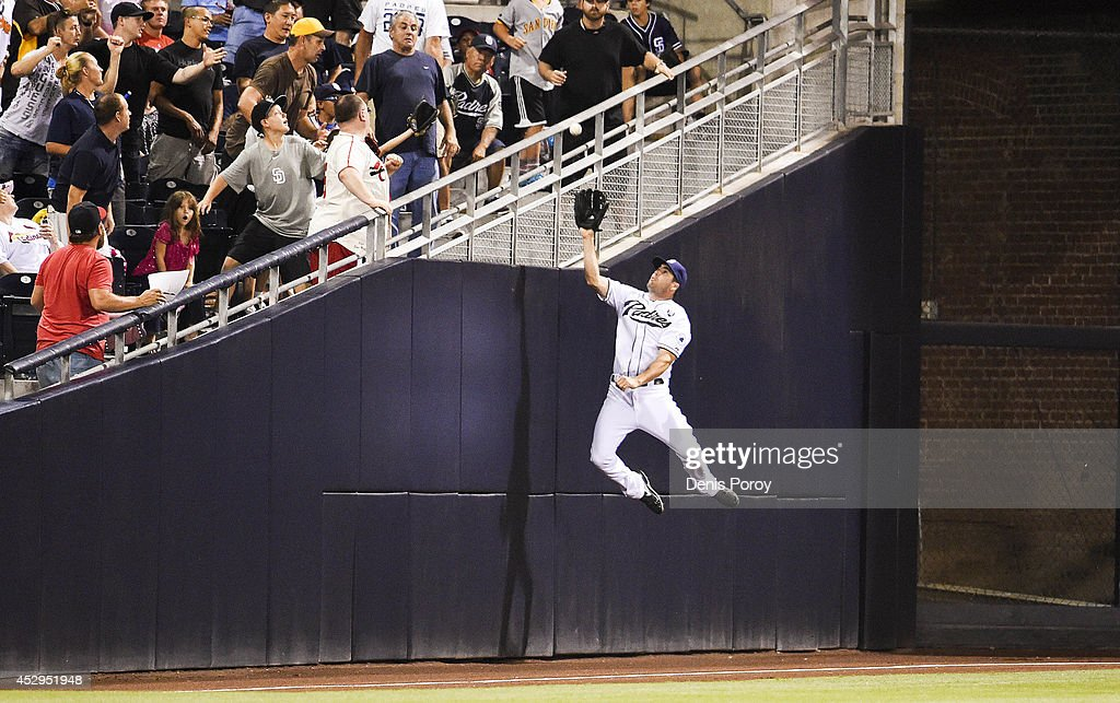 <a gi-track='captionPersonalityLinkClicked' href=/galleries/search?phrase=Seth+Smith&family=editorial&specificpeople=3190174 ng-click='$event.stopPropagation()'>Seth Smith</a> #12 of the San Diego Padres jumps but can't make the catch on a foul ball hit by Matt Carpenter #13 of the St. Louis Cardinals during the sixth inning of a baseball game at Petco Park July 30, 2014 in San Diego, California.