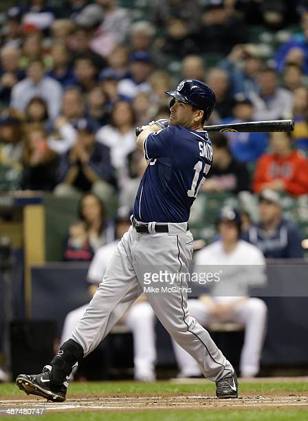 Seth Smith of the San Diego Padres makes doe contact at the plate during the game against the Milwaukee Brewers at Miller Park on April 23 2014 in...