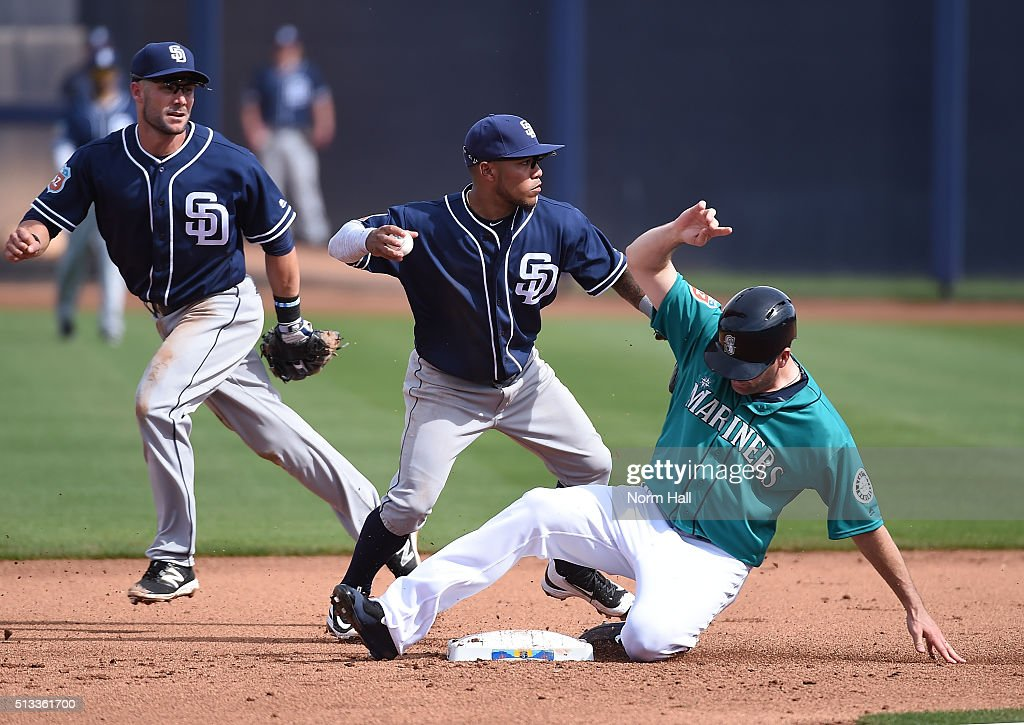 Seth Smith #7 of the Seattle Mariners slides into second base as Alexi Amarista #5 the San Diego Padres turns a double play during the fourth inning at Peoria Stadium on March 2, 2016 in Peoria, Arizona. Mariners won 7-0.