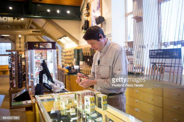 Seth Taylor a fishing representative goes through inventory at the flagship LL Bean store LL Bean is offering early retirement packages to about 900...