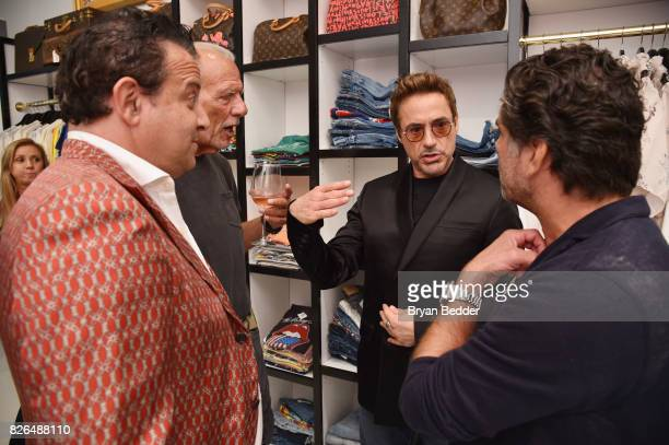 Seth Weisser Frank Bober Robert Downey Jr and Gerard Maione attend the Rachel Zoe x What Goes Around Comes Around popin on August 4 2017 in East...